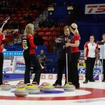 Team Ontario skip Julie Hastings disusses with a CCA official as third Christy Trombley second Stacey Smith and lead Katrina Collins listen, in draw ten action at the Scotties 2015